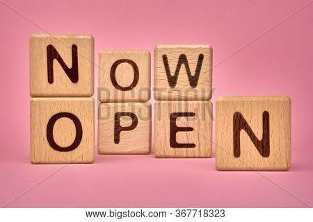 Now Open, Message On Pink Background. Now Open Text On Wooden Cubes. Opened Again After Quarantine D