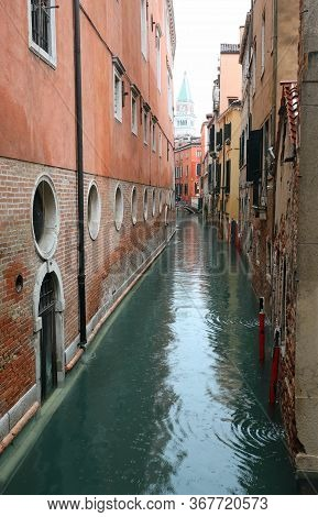 Navigable Canal With The Houses Of Venice And In The Background The Bell Tower Of Saint Mark