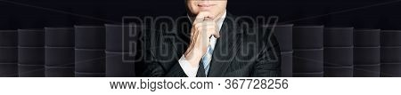 Businessman Or Politics Hand And Crude Oil Barrel On Black Background. Crude Oil And Petroleum Indus