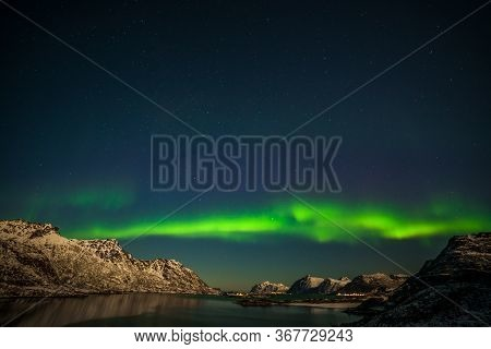 Northern Lights, Aurora Borealis Over Fjord Mountains With Many Stars On The Sky In Lofoten Islands,
