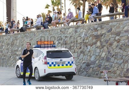 Barcelona, Spain - May 23, 2020: Barcelona Beach Police Car. Covid 19 Coronaviruse Disease. Barcelon