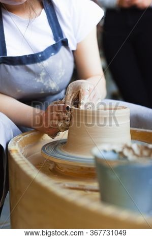 Creating A Jar Or Vase Of White Clay Close-up. Master Crock. Man Hands Making Clay Jug Macro. The Sc