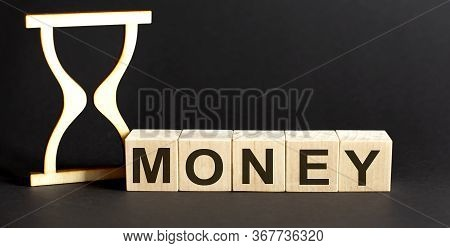 Wooden Blocks Money With Sand Clock On Table. Personal, Career Or Business Development, Mindset Conc