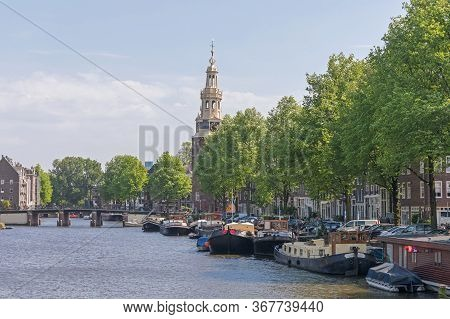 Houseboats Moored At Canal In Amsterdam Netherlands
