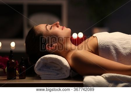 Girl Lies At Home Under After Beauty Spa Procedure. Massage During Quarantine Using Relaxation Techn