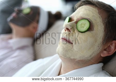 Husband And Wife Put Makeup Mask On Face At Home. Cleansing And Matting Masks For Male Skin Prone To