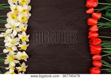 Red Tulips And Daffodils On Textured Wooden Background With Space For Text. Holiday Greeting Card, B