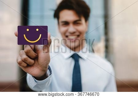 Customer Experiences Concept. Young Businessman Feedback A Happy Face Icon And Positive Review On Ca