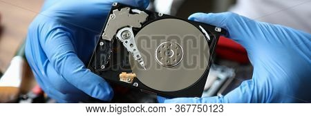 Gloved Hands Show Computer Hard Drive, Need Repair. File System Repair And Recovery. Free Diagnosis