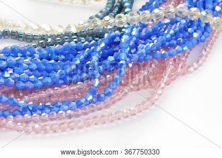 Mix Of Color Faceted Glass Sparkle Beads. Materials For Creative Work On White Background.