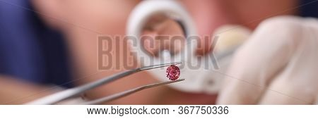 Male Looks Through Magnifying Glass Brink Diamond. Man Checks Safety Product And Stone, Cleans And P