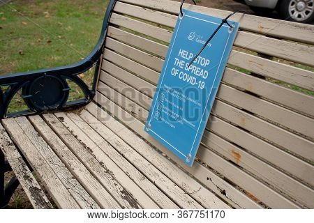 Sydney, Australia 2020-05-24 Help Stop The Spread Of Covid-19. Health Orders Sign On A Bench In A Pu