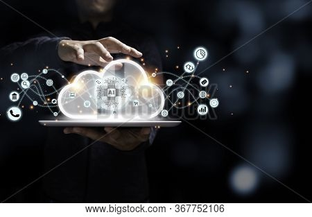 Businessman Holding Tablet With Artificial Intelligence Virtual Cloud Computing And Business Icon. C