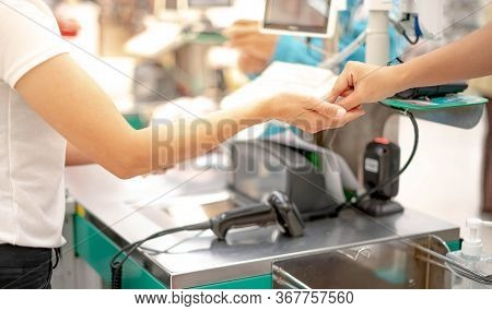Female Hand With Coin Money Pay For Goods Concept. Hand Giving Cash And Hand Receiving Cash, Payday
