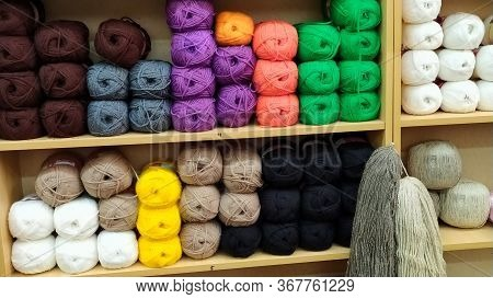 Skeins Of Yarn Are On The Shelves Of The Store. Balls Of Yarn For Knitting. Colored Threads Are On T