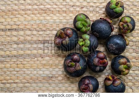 Mangosteens Placed On Traditional Wickerwork Texture Made Form Dried Stalk Water Hyacinth Or Eichhor