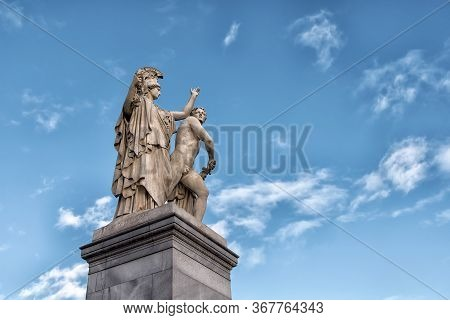 Berlin, Germany - December 9, 2019: The Sculpture On The Schloss Bridge Schlossbruecke - Greek Godde