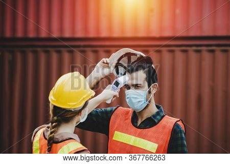 Industrial Worker Woman Temperature Checking Fever By Digital Thermometer With Engineer Man With Car