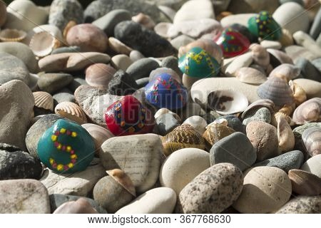 Bright Painted Seashells With Letters Forming Word Summer Among Beach Stones And Seashells