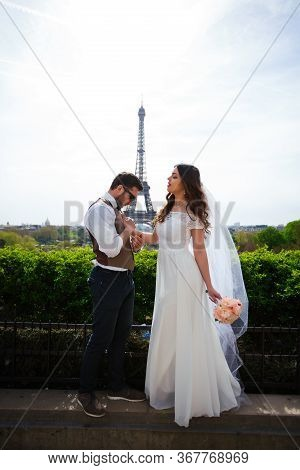Newly Married Couple In Paris Near The Eiffel Tower