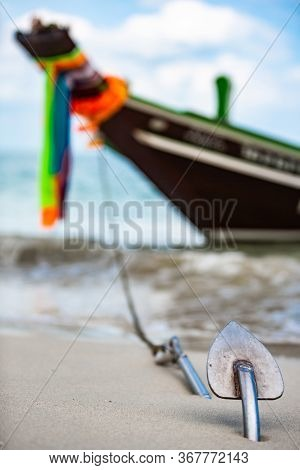 Differential Focus. Waiting For Its Passengers Traditional Thai Longtail Boat With Flowers And Ribbo