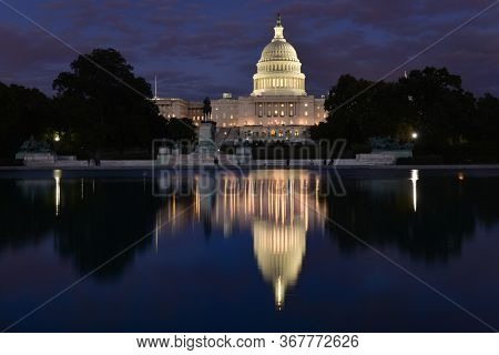 U.S. Capitol Building at night with a reflection over the reflection pool - Washington D.C. United States of America