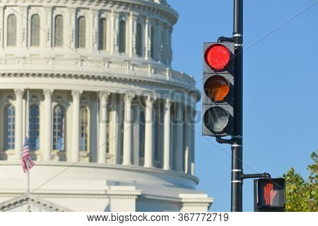 Red traffic light and U.S. Capitol Dome that symbolizes negative political decision -  Washington D.C. United States of America
