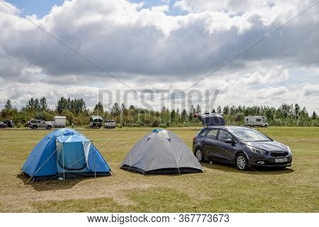 Southwest Iceland - June 29, 2014: A Green Meadow In A Tramping Camp In Iceland, Europe With Kia Cee