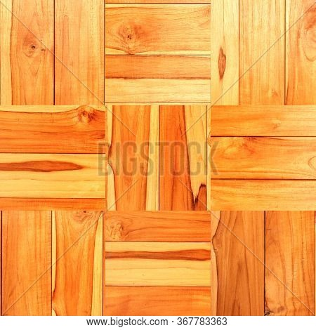 Texture of wooden floor with square elements. Texture of old wood planks of brown and yellow colors
