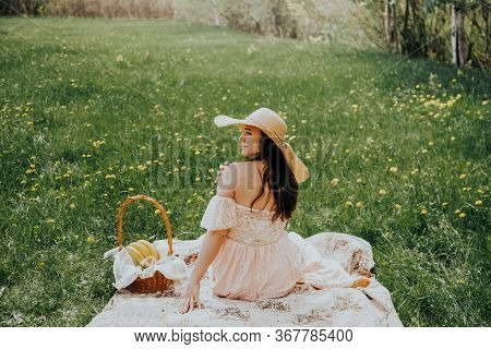 Happy Woman Life Style, Beautiful Relaxed Girl In A Straw Hat On The Nature Picnic Basket Flowers In