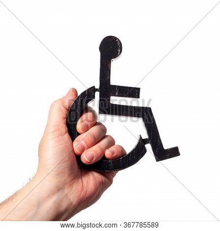 Disabled Symbol Being Held Up My A Human Hand. Power To Disabled People Sign On A White Background