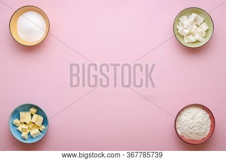 Pie Crust Main Ingredients In Multi-colored Bowls On Pink Seamless Background. Flat Lay With Butter,