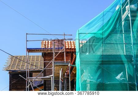Restoration Of A Historic Wooden House And Replacement Of Roof Clay Tiles