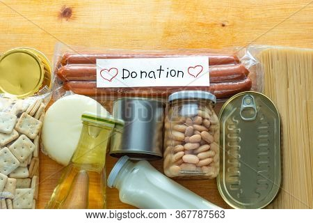 Flat Lay Of Grocery Food Set For Needy In Crisis, Pasta, Beans, Canned Food, And Others On The Table