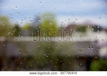 Raindrops On The Windowpane As A Backdrop.