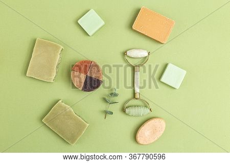 Natural Soap And Face Roller On Geen Background. Self-care. Flat Lay