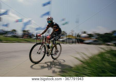 Kuala Lumpur, Malaysia- December 2019 - Panning Blurred Motion Shot Of Commuter On A Bicycle. A Man