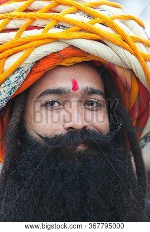 Bikaner, India - January 12, 2020: Indian Man With Big Turban On His Head, With Beard And Long Musta