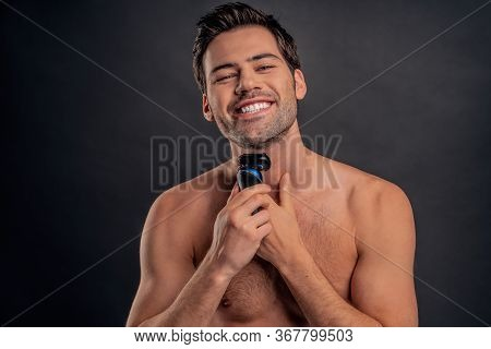 Handsome Young Bearded Man Isolated. Portrait Of Topless Muscular Man Is Standing On Gray Background