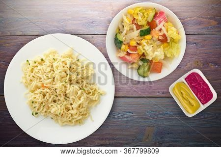 Vermicelli On A White Plate On Purple Wooden Background. Vermicelli On A Plate With Vegetarion Salad