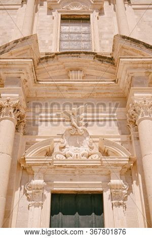 Facade Of The Church Of Saint Ignatius In Dubrovnik, Croatia. Statue Of An Angel Above The Entrance