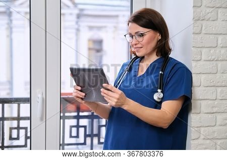 Female Doctor Talking Online With Patient Using Digital Tablet Computer, Video Call, Technology, Doc