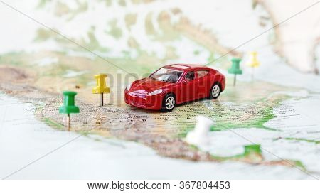 Road Trip At Homeland - Red Car Goes On Map Across Territory Of Usa. Route Of Automobile Travel Is L