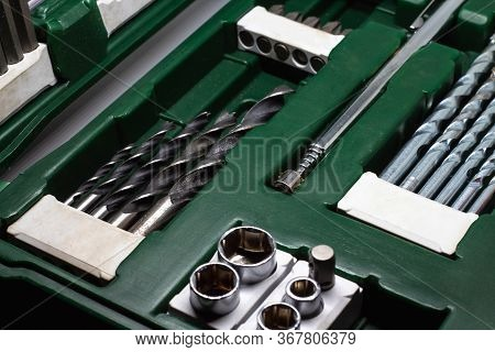 Set Of Nozzles For A Screwdriver With Drills, Screwdrivers Close-up. Case For A Screwdriver In Dark