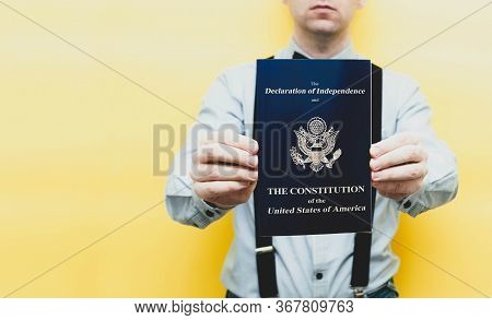Cropped View Of Man In Shirt Holding Blue Brochure With Usa Constitution And Independence Declaratio