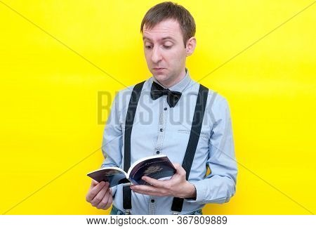 Handsome Disappointed Man In Shirt And Suspender Reading Usa Constitution And Independence Declarati