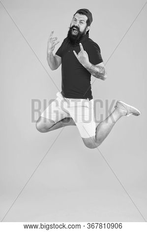Inspired Concept. Always In Motion. Enjoying Active Lifestyle. Happy Guy Jumping. Active Bearded Man