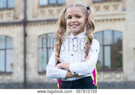 Happy First Day At School. Little Girl On September 1. Small Child Back To Learn On September 1. Kno