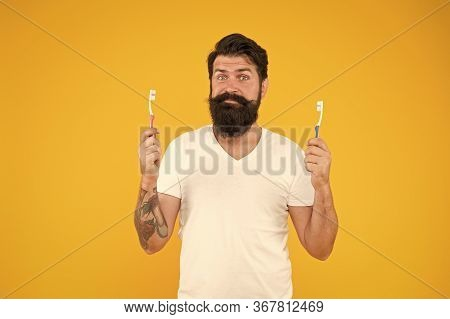 Brush Teeth Concept. Teeth Hygiene. Ultrasonic Teeth Cleaning Technology. Bearded Man Holds Toothbru