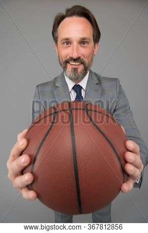 Play Basketball Be Happy. Happy Businessman Hold Basketball Ball. Basketball Coach Grey Background.